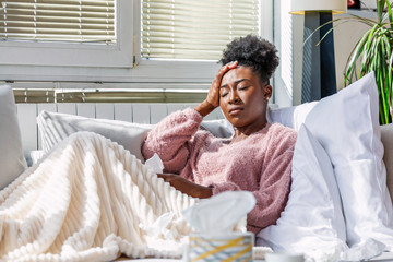 Cold And Flu. Portrait Of Ill African American Woman Caught Cold, Feeling Sick And Sneezing In Paper Wipe. Closeup Of Beautiful Unhealthy Girl Covered In Blanket Wiping Nose. Healthcare Concept.