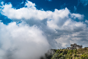 Old casino of Bokor mountain in front of clouds coming from the valley, Cambodia