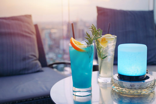 Tasty colorful summer cocktail for couple on rooftop bar date night, luxury and romantic concept