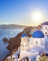 Wall Murals Lavender Oia town on Santorini island, Greece. Thira village in the sunset with view onthe sea.