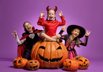little witch, Dracula and pumpkin on purple background