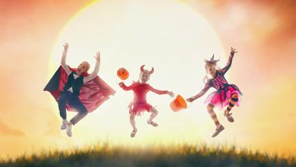 kids in Halloween carnival costumes