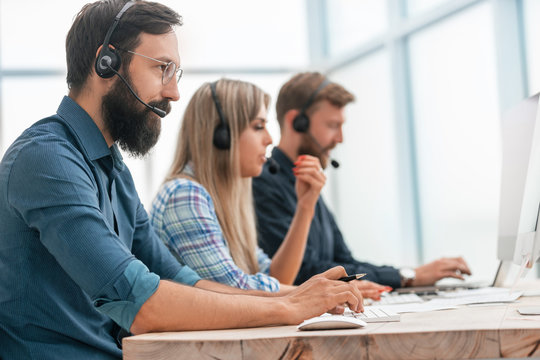 close up. call center operators work in a modern office.