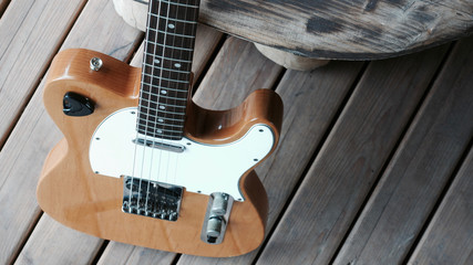 electric guitar on the wooden boards at country barn