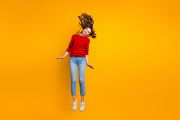 Full size photo of cute lady jumping high wear knitted sweater isolated yellow background