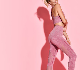 cropped photo of sexy sporty woman with nice fitness body over pink background