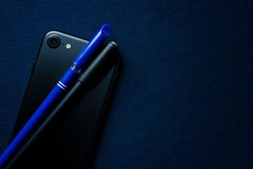 modern mobile phone pens blue silk close up elegant stock photo