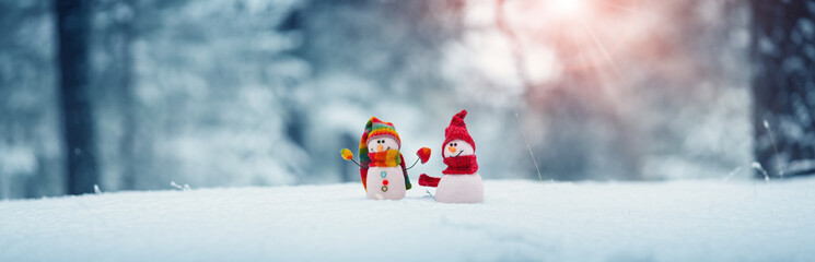 little snowmans on soft snow on blue background Fotobehang