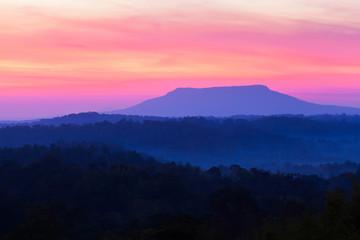 Scenery of blue mountain and sunrise sky.