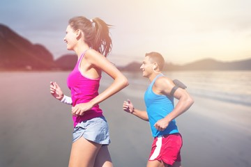 Fitness, sport, friendship and lifestyle concept - smiling couple  running together