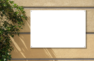 Mockup of a poster on an outdoor wall