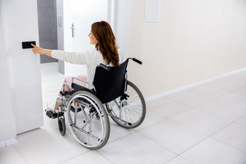 Disabled woman entering clinic room stock photo