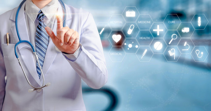woman doctor holding hand and touching visual screen with hospital background