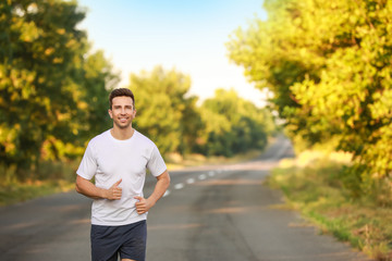Sporty young man running outdoors