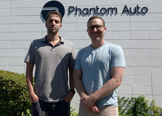 Phantom Auto co-founders Shai Magzimof and Elliot Katz pose for a photo at the company's Silicon Valley headquarters in Mountain View
