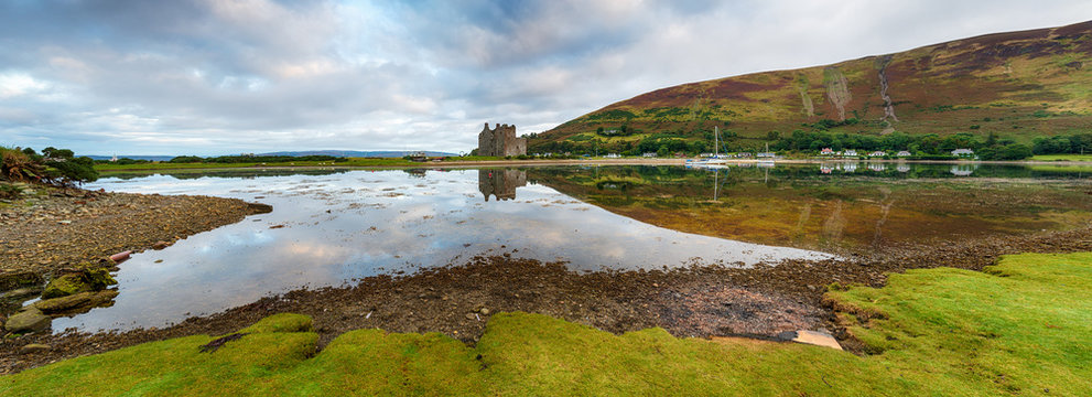A panoramic view of the 13th century castle at Lochranza at high tide on the Isle of Arran in Scotland
