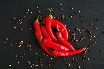Aluminium Prints Hot chili peppers Hot chili peppers and peppercorn on dark background