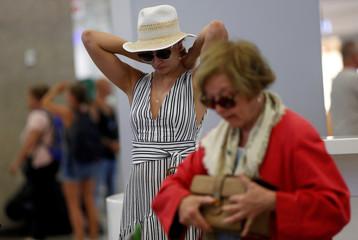 Thomas Cook passengers queue up at a check-in service at Malta International Airport