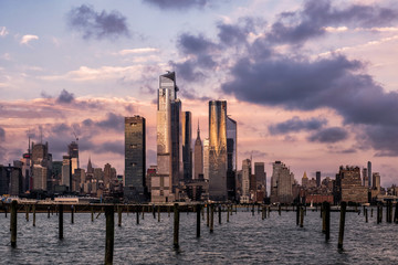 Sunset at Hudson Yards skyline of midtown Manhattan view from Hudson River