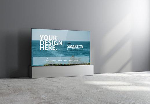 Smart TV Mockup Against Grey Wall