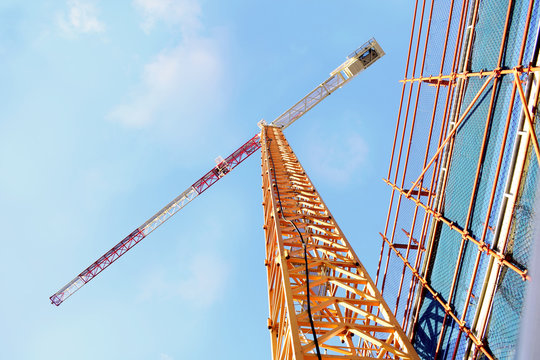 Construction - A large crane reaches for the sky