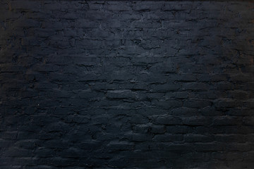 Black brick wall background. Backdrop of design interior in grunge style. Rough surface with...