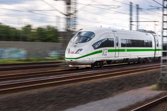 troidsorf, North Rhine-Westphalia/germany - 13 08 19: ICE train speeding with new green paint near troisdorf germany