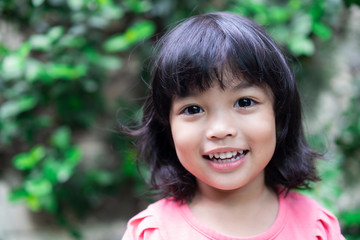 Happy smiling Asian kid. Face expression concept.