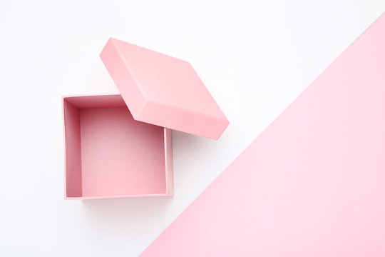 Open pink gift box on colorful background