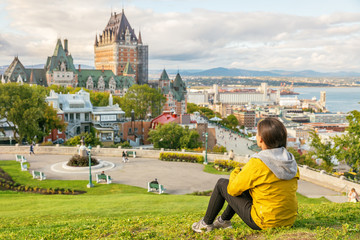 Aluminium Prints Canada Canada travel Quebec city tourist enjoying view of Chateau Frontenac castle and St. Lawrence river in background. Autumn traveling holiday people lifestyle.