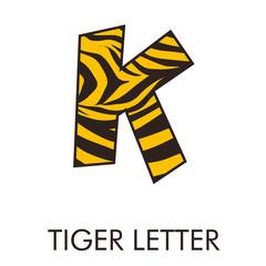 Obraz Logotipo letra K con patrón de piel de tigre en amarillo y marrón - fototapety do salonu