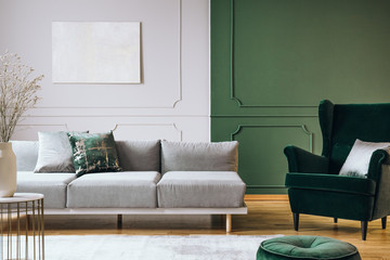 Abstract oil painting on grey wall with moldings in contemporary living room interior with grey...