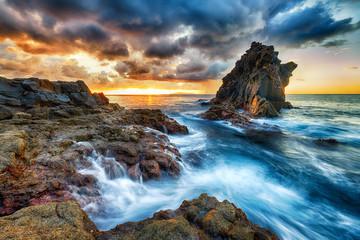 Beautiful summer sunset on sea shore