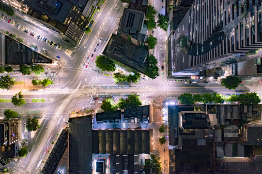 Bird's Eye View of City Streets and Skyscrapers at Night