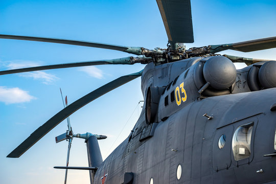 Military heavy helicopter, army air means of transport, air force, aviation and aerospace industry, dark gray big copter with rotor