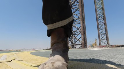 Wall Mural - Worker walks in the helideck of a jack up drilling rig