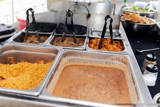 Catered event has traditional Mexican taco makings of rice, beans, pork al pastor, pollo, and carne asada tacos.