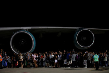 British passengers board an Airbus A380 airliner that is being used for transporting Thomas Cook customers at Dalaman Airport
