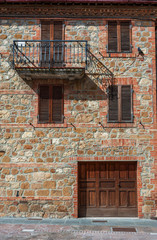 Fototapete - Old residential building in Pienza, Tuscany, Italy