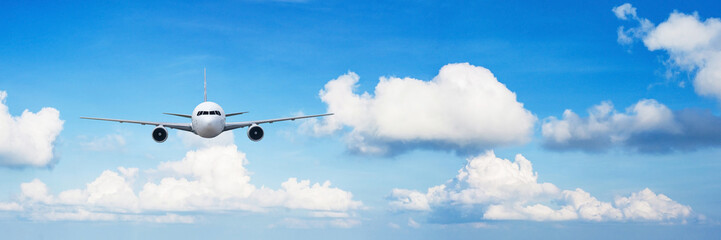 Front of real plane aircraft, isolated on big blue sky view background