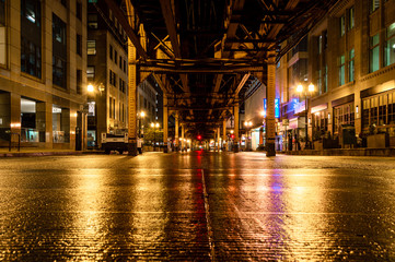 Underneath the elevated train tracks at Wells Street in the Chicago Loop at night.
