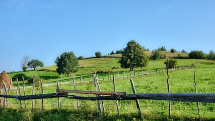 Typical Countryside Landscape Of Romania With Wooden Fence