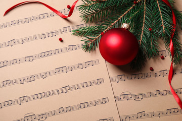Fotobehang - Flat lay composition with Christmas decorations on music sheets, space for text