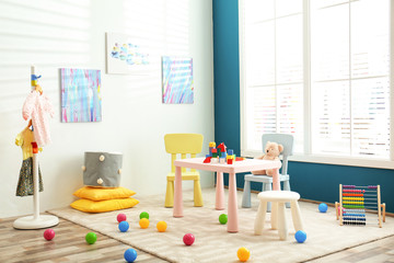 Baby room interior with color furniture and toys