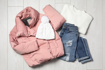 Fototapete - Flat lay composition with winter clothes on white wooden background