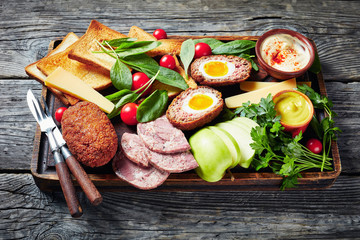Tuinposter Eten ploughman's lunch on a wooden board, close-up