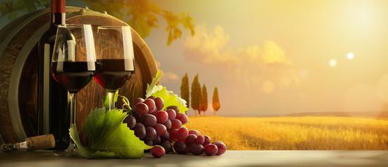 autumn countryside wine background; vine, red wine bottles, wineglass, wine barrel; wine tasting...