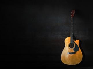 Acoustic guitar on a black background , vintage tone sunrise