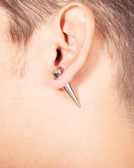 ear piercing tunnel extension  close up