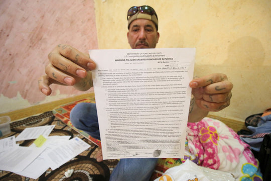 Hani al-Bazoni, who was deported from the United States to Iraq under U.S. President Donald Trump's strengthened immigration enforcement, shows his deoprting letter during an interview with Reuters at his home in Basra